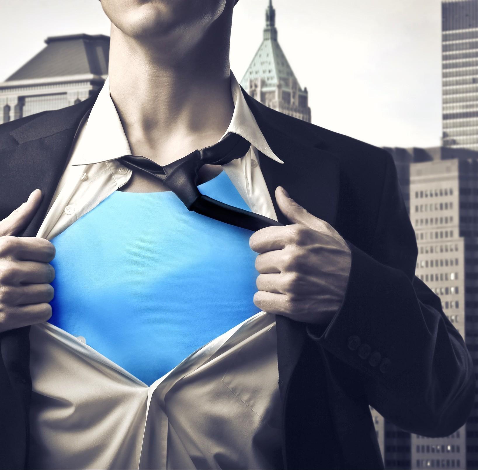 Closeup of a businessman showing the superhero suit under his sh